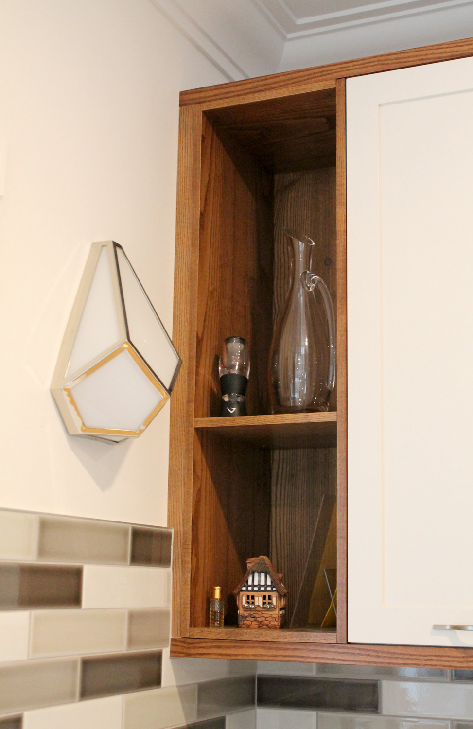 Corner cabinet detail with wall sconce