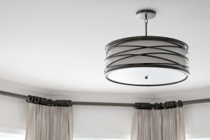 Living room light fixture and custom drapery